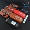 ซองหนังแท้ ใส่กุญแจรีโมทรถยนต์ รุ่นปุ่มขาว Mazda 2,3/CX-3,5 Smart Key 2 ปุ่ม