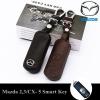 ซองหนังแท้ ใส่กุญแจรีโมทรถยนต์ รุ่นหนังนิ่มโลโก้-เหล็ก Mazda 2,3/CX-3,5 Smart Key 2 ปุ่ม