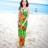 ชุดเดรสเที่ยวทะเลยาวสีส้มเขียว พิมพ์ลาย เย็บคล้องคอ ใส่ไปเที่ยวทะเล สวยเก๋