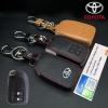 New ซองหนังแท้ ใส่กุญแจรีโมทรถยนต์ Toyota New Yaris 2014-17 แบบ Push Start โลโก้เงิน รุ่น 2 ปุ่ม