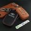 ซองหนังแท้ ใส่กุญแจรีโมทรถยนต์ รุ่นเรืองแสง Toyota Fortuner/Camry Hybrid Smart Key 4 ปุ่ม thumbnail 7