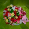ช่อเฟอเรโร่ (Ferrero Rocher) จำนวน 9 ลูก ดอกกุหลาบสีชมพูอ่อน สลับแดง