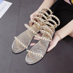 รองเท้าแตะส้นแบน แฟชั่นหนังpu สีทอง แบบพันข้อลายงู แต่งอะไหล่มุก