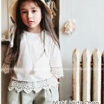 เสื้อเด็กหญิงสีขาวชายลูกไม้